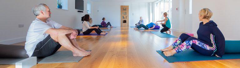 Yoga retreats retreaters sitting up on mats